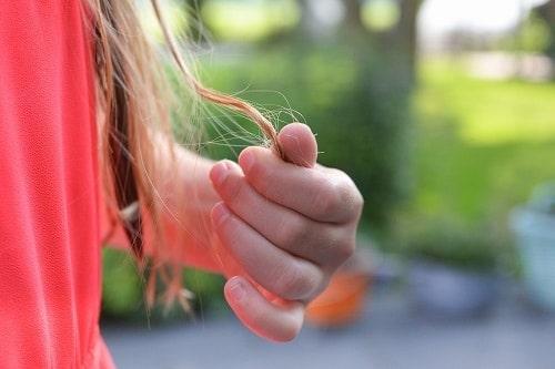Girl curling her own hair