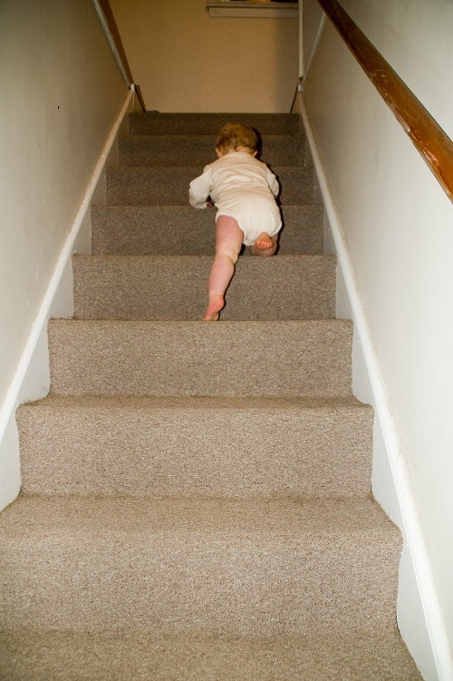 baby climbing in stair