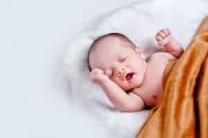 new born baby with brown blanket
