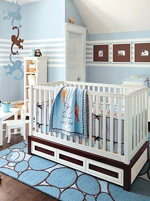 Blue minimalist  money themed nursery with hanging barrel of monkeys