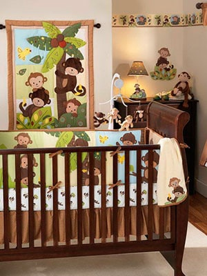 a monkey theme for a babes nursery featuring wall hangings and lamp