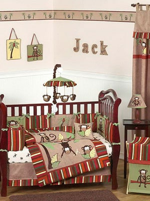 Red monkey themed baby nursery with jack on wall and monkey mobile