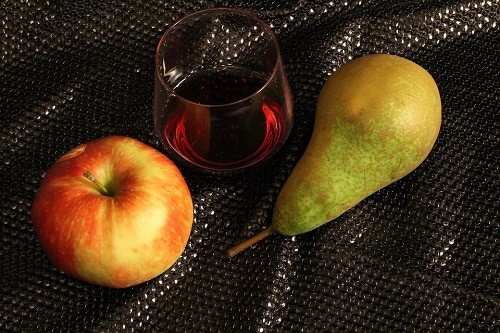 Apple and pear with the glass