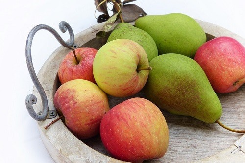 Pears amd apple on the brown tray wood