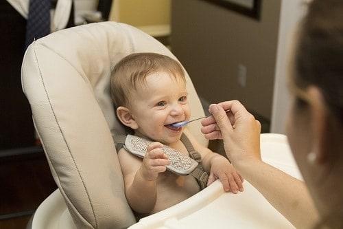 Girl feed the baby