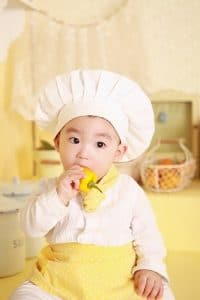 Baby Chef holding bell pepper