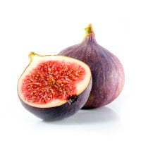 two figs, one cut in half revealing ripe red flesh