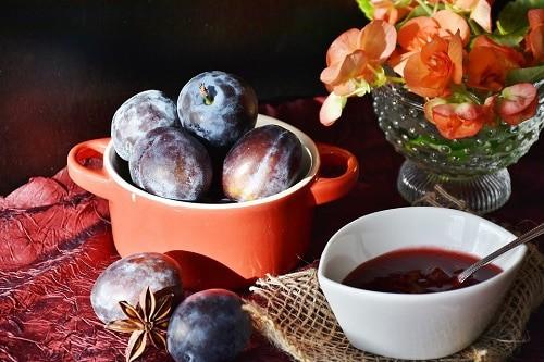 Plum purple beside bowl and spoon
