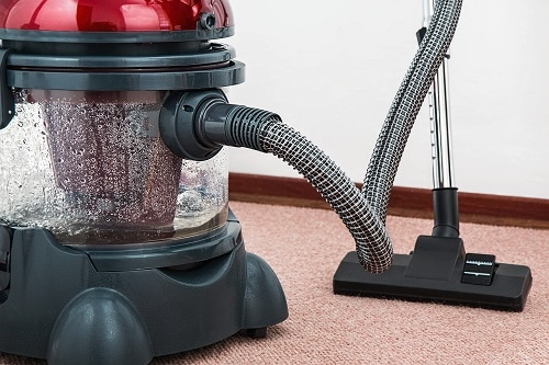 Black and red canister vacuum