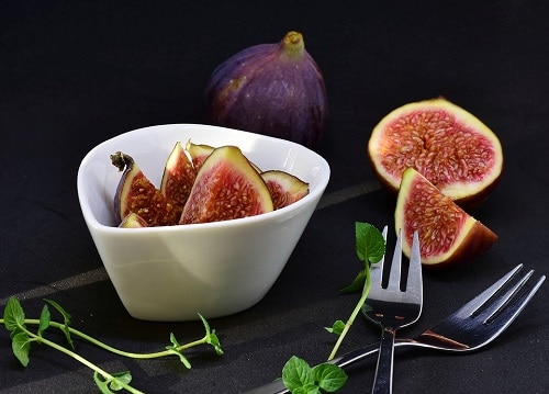 Figs Fruit beside Fork and leaves