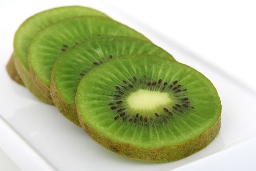 Sliced of Kiwi in a white tray