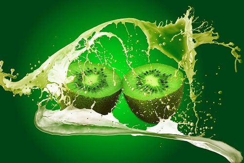 Sliced Kiwi with green background