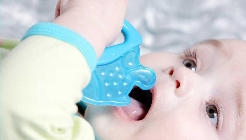Baby sucking on teether