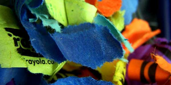 scraps of removed crayon wrapper