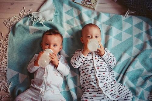 two babies lying