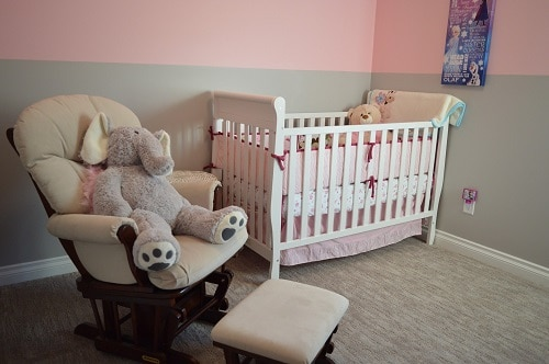 Teddy bear inside the crib