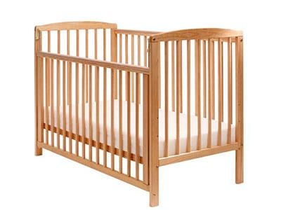 drop side baby crib with side rail dropped down