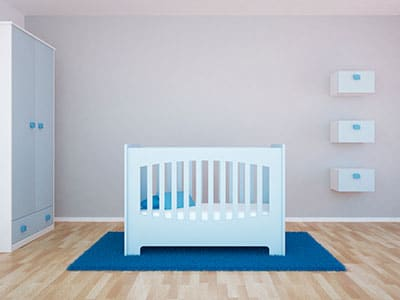 matching themed cabined, shelf and baby crib in nursery