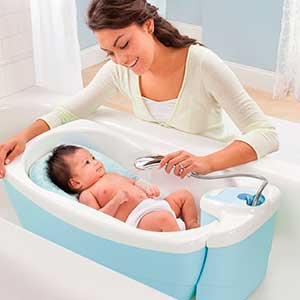 baby being washed in luxury baby bath tub