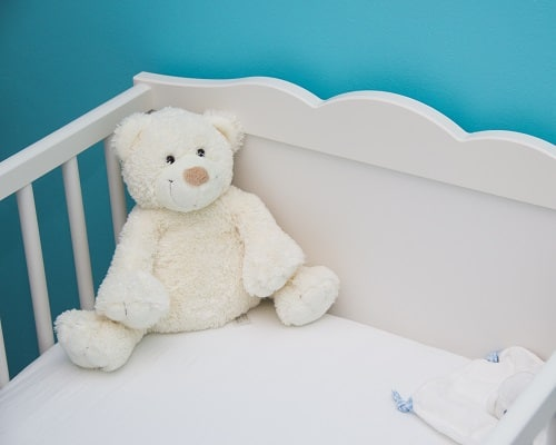 baby crib with white bear