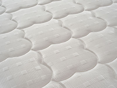 close up of a crib mattress cover