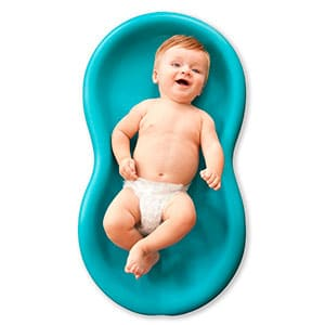 baby laying in a keeper diaper change pad