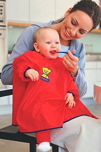 baby wearing long sleeved baby bib (smock)