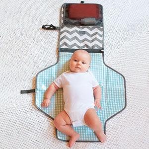 baby laying on diaper changing kit