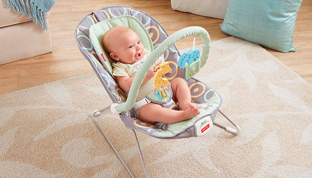 a baby happily bouncing in his baby bouncer