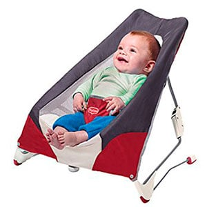 baby sitting in a basic baby bouncer