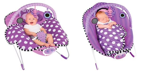 baby sleeping in baby bouncer with blanket
