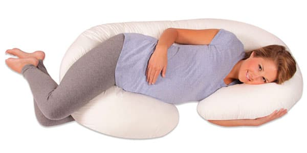 pregnant woman sleeping on a C shaped body pillow