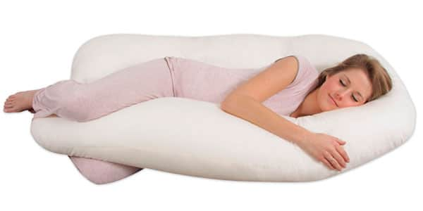 pregnant woman sleeping on a U shaped body pillow
