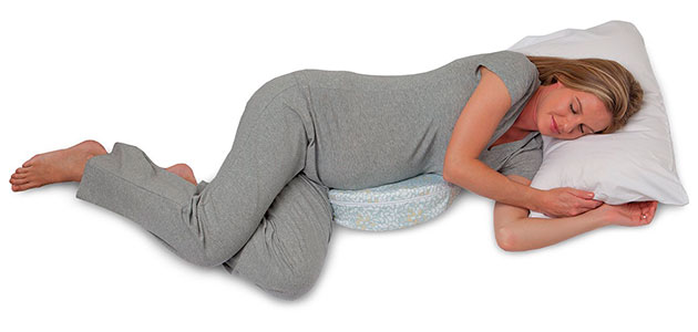 pregnant woman sleeping on a pregnancy wedge pillow