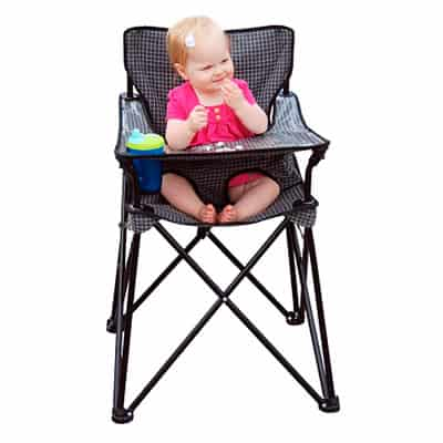 baby girl in pink dress sitting in travel high chair