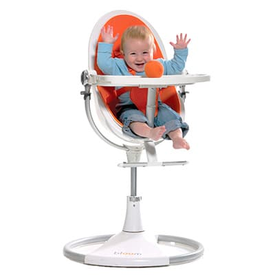 baby sitting in a highly adjustable modern high chair