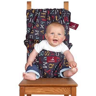 fabric high chair keeping baby secured to dining chair