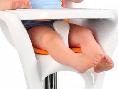 baby legs sticking out either side of a crotch post