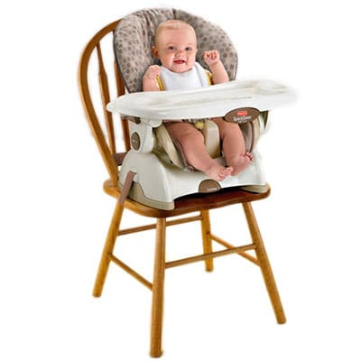 baby sitting in a space saver high chair