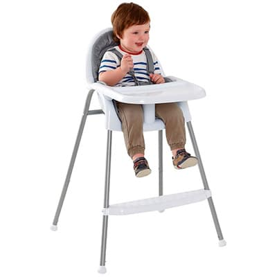 baby sitting in a traditional single piece high chair
