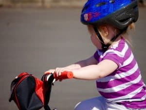 Girl wearing blue bike helmet