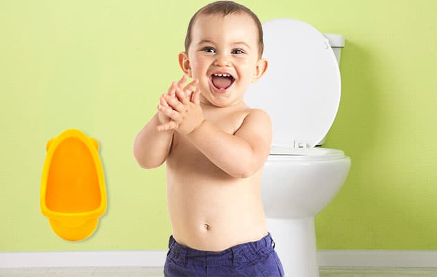 little boy about to use a potty training urinal