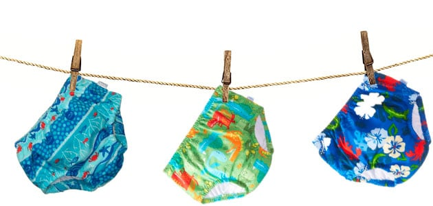 swim diapers drying out on a clothes line