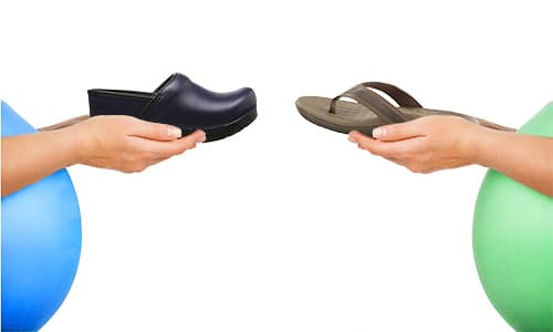 two pregnant women holding comfortable shoes