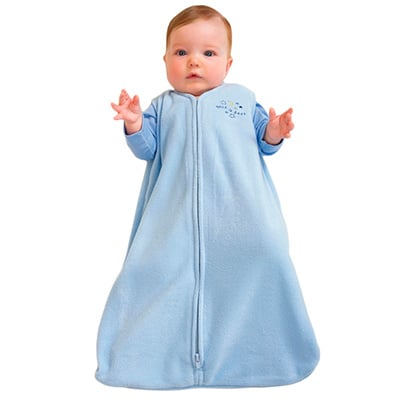 baby covered by blue sleep sack