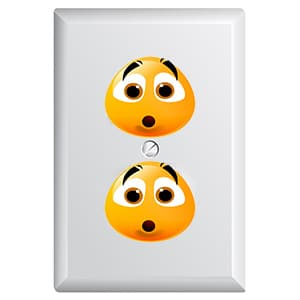 electrical outlet with smiley faces on it (what a baby sees when he looks at an outlet)