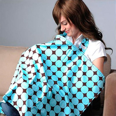 Mother breast feeding with nursing cover hiding baby