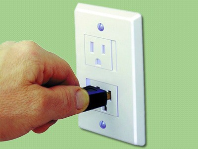 plugging into a baby proof power outlet cover that slides