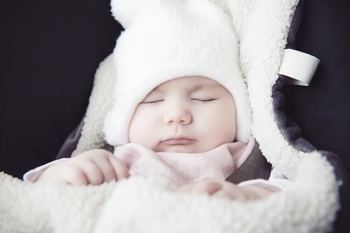baby sleeping with covered blanket