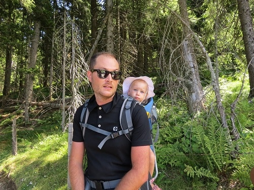 man and baby in the forest